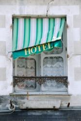 A very shabby hotel window.