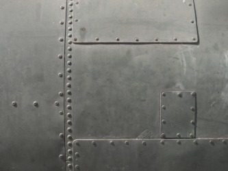 A piece of metal with rivets.