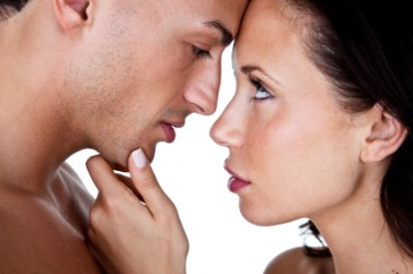 Two people looking at each other with desire.