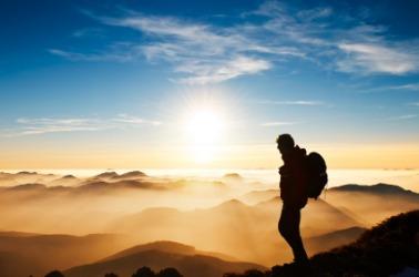 A hiker enjoys a beautiful view.