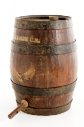 A peg protruding from a wine barrel.