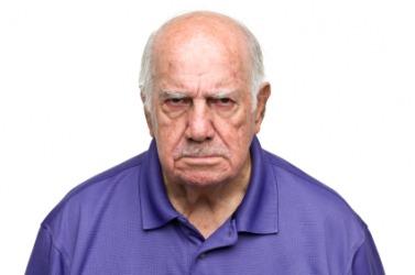 A scowling man.