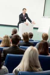 A man gives a lecture at a business conference.