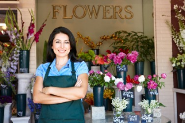 This woman works in a flower shop.