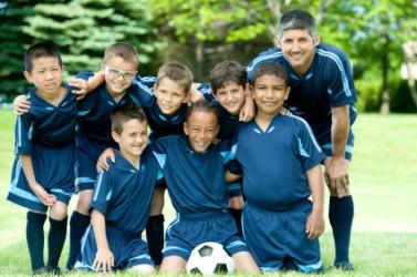 A soccer team in their uniforms.
