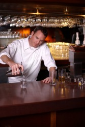 A bartender pouring a drink.