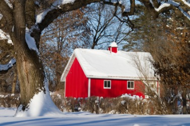 A red barn in the snow.