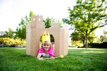 A little girl plays in her make-believe castle.