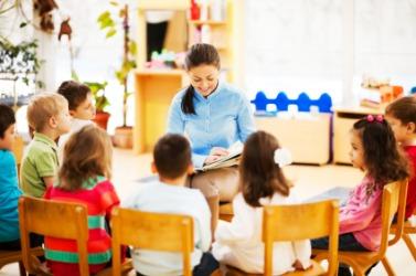 A teacher narrates a story to her class.