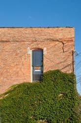 A narrow window in a brick building.