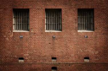 Barred prison windows.
