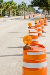 Orange barrels form a temporary barricade.
