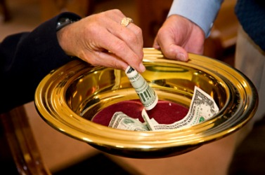 A person making an offering in church.