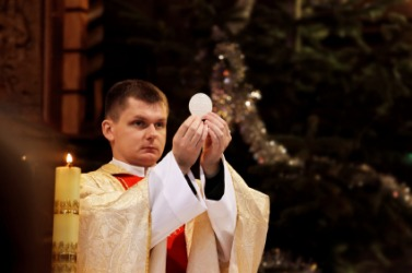 A priest officiates over communion.