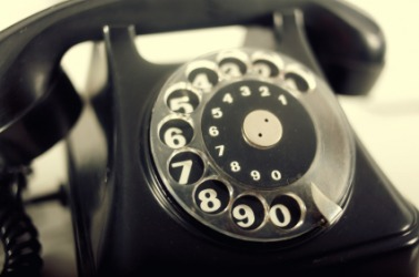 An old-fashioned rotary telephone.