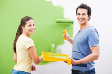 A couple paint their walls green.