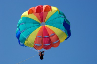 A skydiver under his parachute.