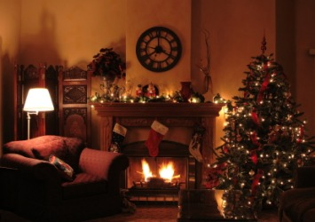 A parlor decorated for Christmas.