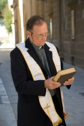 A parson holding his Bible.
