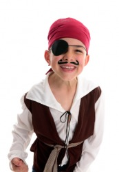 A little boy plays pirate wearing an eye patch.