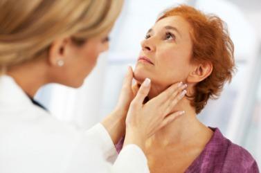 A doctor examines her patient.