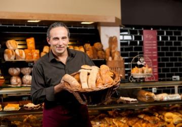 A baker in a patisserie.