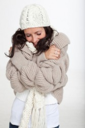 A woman quivers from the cold.