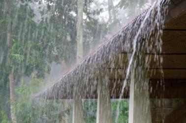 Rain falling on a roof.