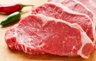 Three raw steaks.