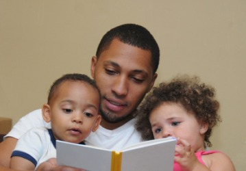 A father reads to his children.