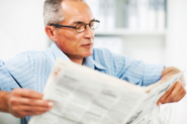 A man reading a newspaper.
