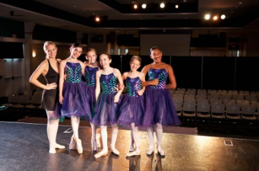 Teacher and students prepare for a ballet recital.