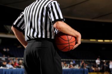 A basketball referee.