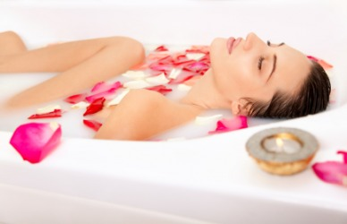 A woman taking a refreshing bath.
