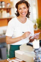 A salesclerk attends the cash register.