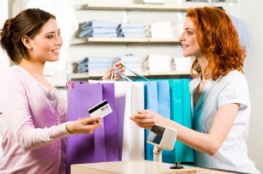 A saleslady assists a customer.