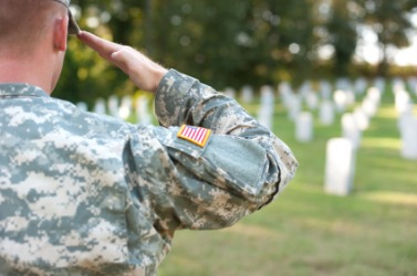 A soldier gives a salute to fallen comrades.