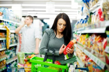 A woman performs the task of shopping.