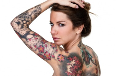 A woman displays her tattoos.