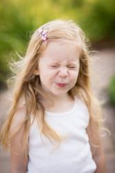 A little girl in an undershirt.