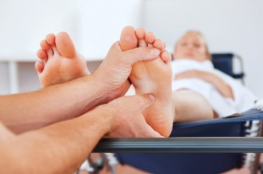 A person gets a foot massage to unwind.