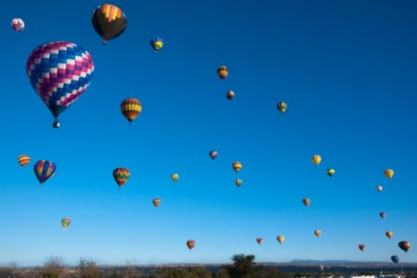 Hot air balloons up in the sky.