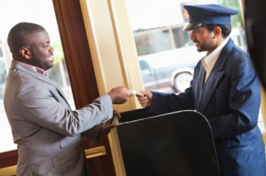 A hotel valet assists a guest.