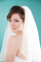 A bride wearing a veil.
