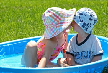 Two children in a wading pool.