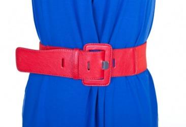 A red belt around a womans waist.