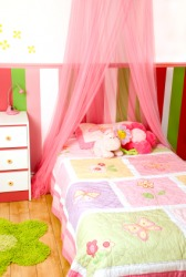 A childs bedchamber, or bedroom.