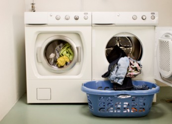 A busy washer and dryer on washday.