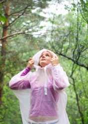 A woman wears a waterproof raincoat.
