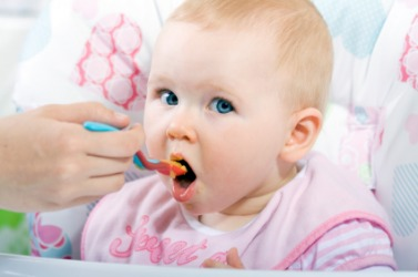 This baby is being weaned onto solid food.